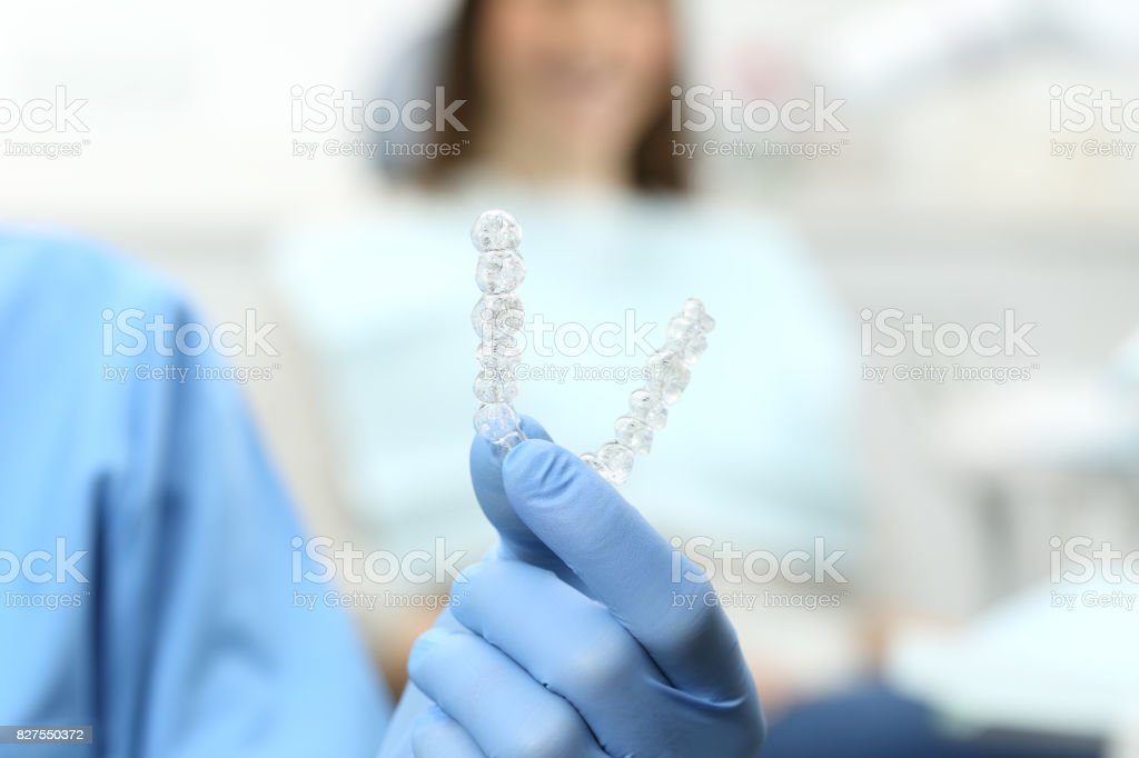 Dentist holding a silicone trainer stock photo