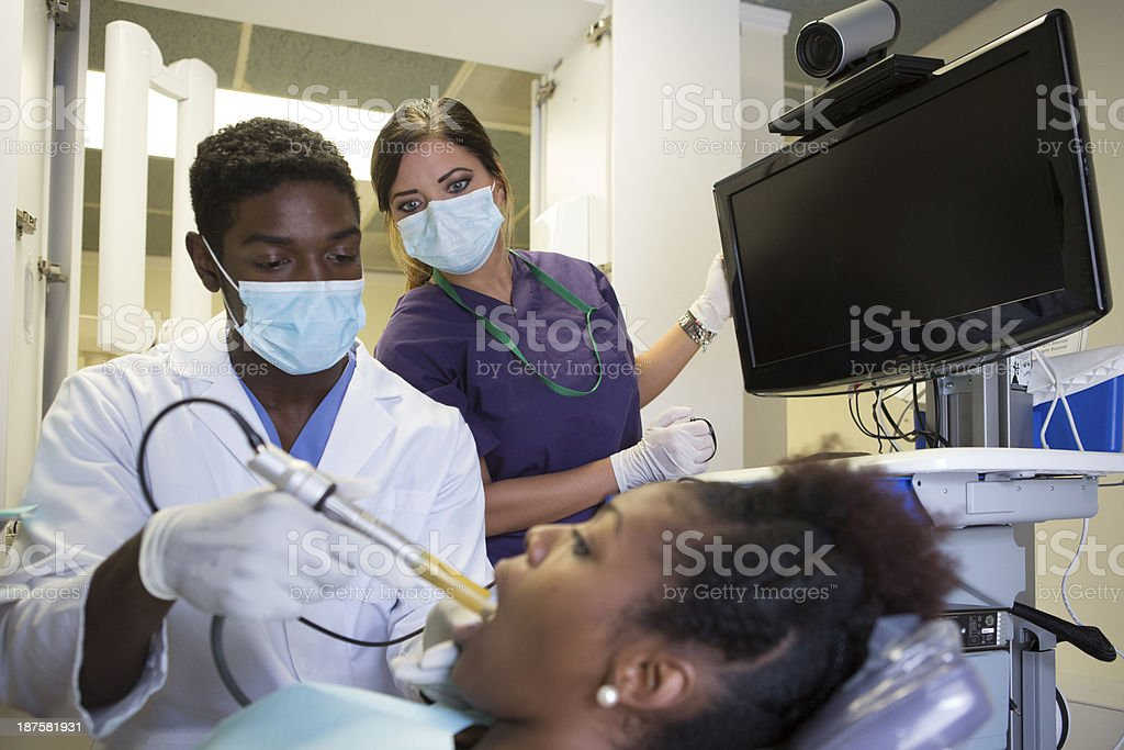 Dentist Hygienist Checking For Cavities Royalty Free Stock Photo