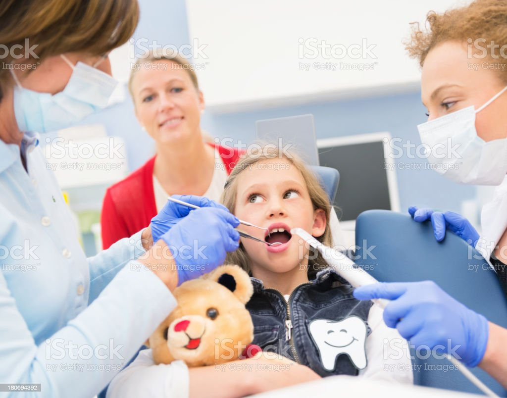 Dentist, Hygienist, Mother and Girl royalty-free stock photo