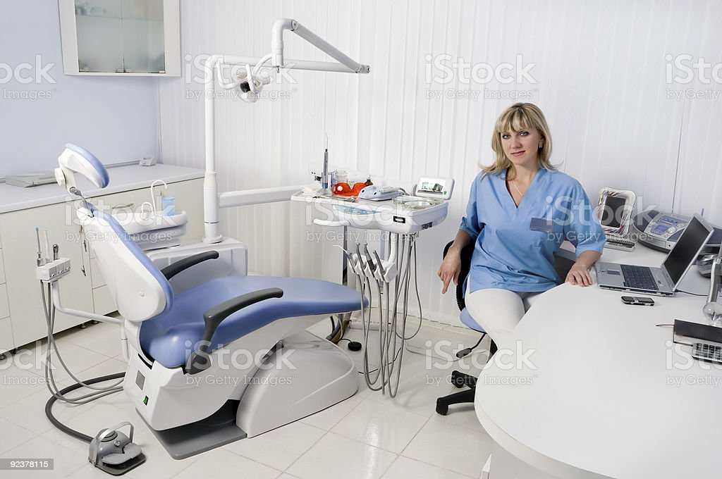 dentist in her office royalty-free stock photo
