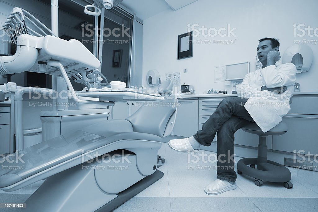 Dentist in his office royalty-free stock photo