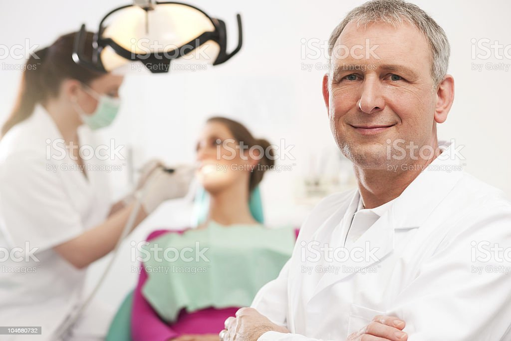 Dentist in his surgery royalty-free stock photo