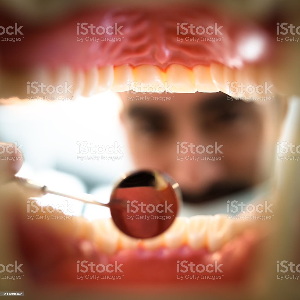 dentist inspecting the teeth stock photo