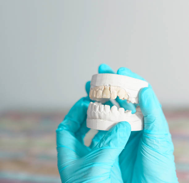 Dentist is working on facial dental prosthetic stock photo