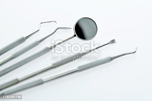 Dentist medical tools on white background.
