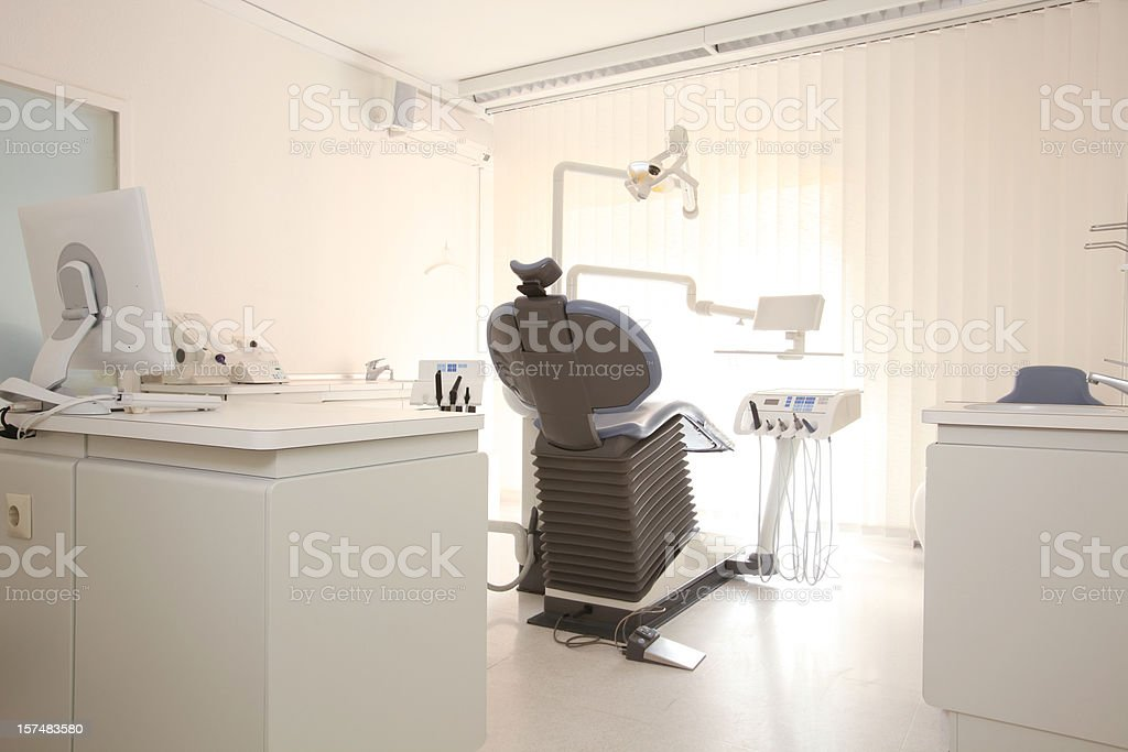 Dentist room, computer and treatment chair royalty-free stock photo