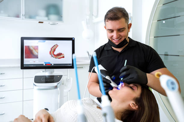 Dentist scanning patient's teeth with a CEREC scanner Dentist scanning patient's teeth with a CEREC scanner 3d scanning stock pictures, royalty-free photos & images