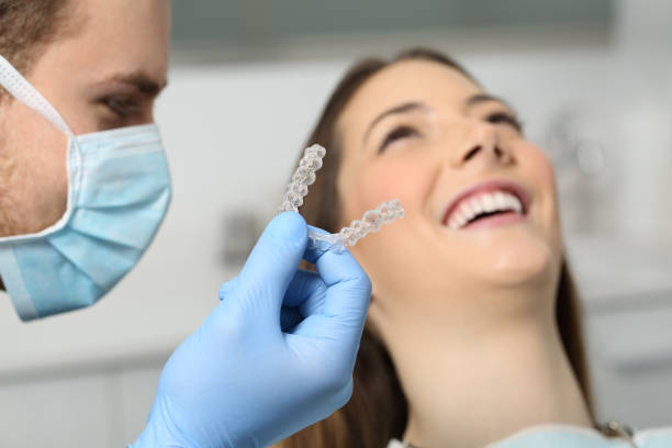 Dentist showing an implant to a patient stock photo