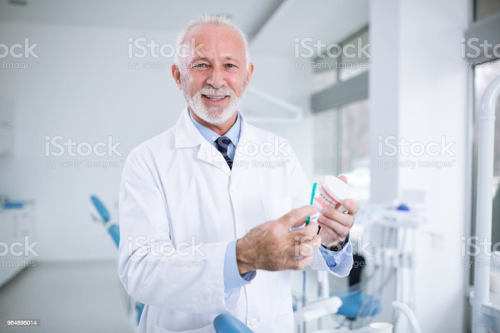 Dentist shows how to wash your teeth correctly royalty-free stock photo