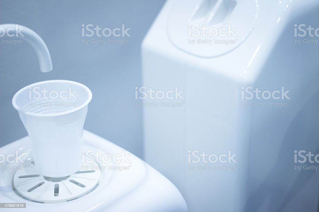 Dentist water rinse cup tap filler in dental clinic stock photo