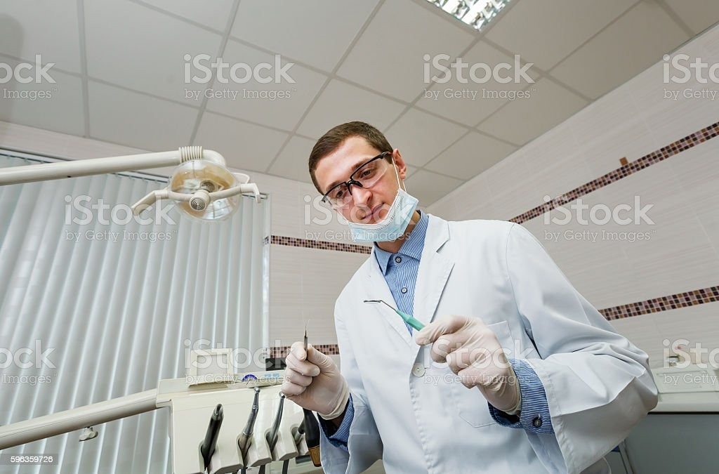 Dentist while working royalty-free stock photo