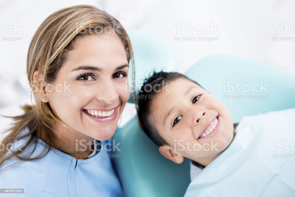 Dentist with a young patient stock photo