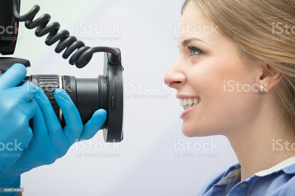 Dentist with camera and patient stock photo