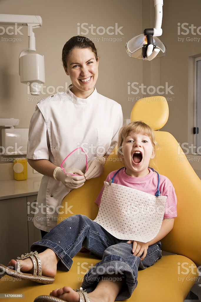 Dentist with little girl patient royalty-free stock photo