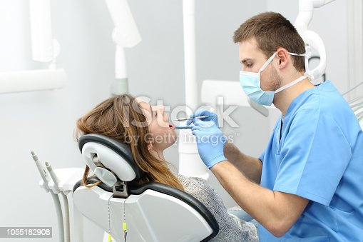 istock Dentist working with a patient 1055182908