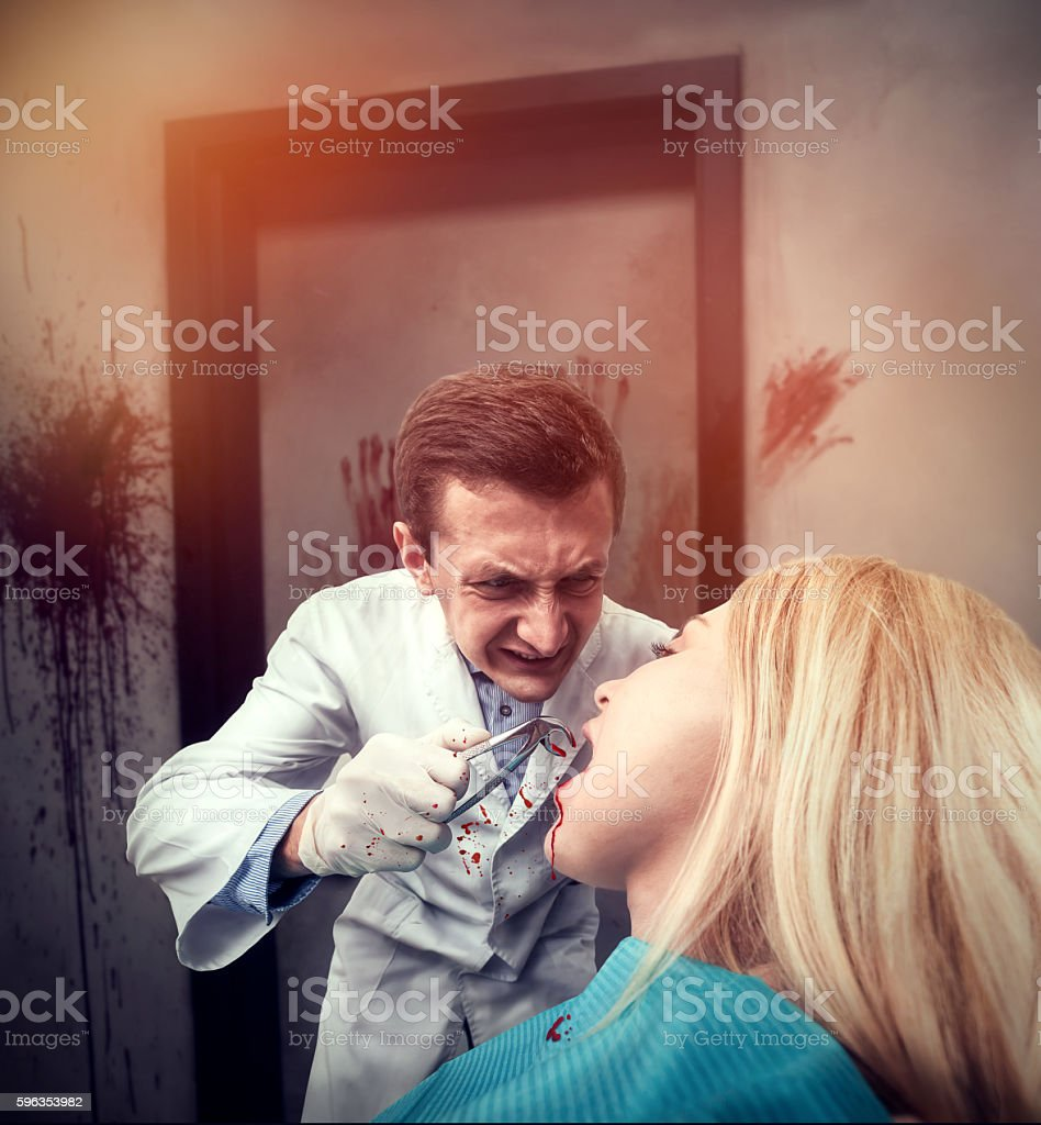 Dentist working with woman royalty-free stock photo