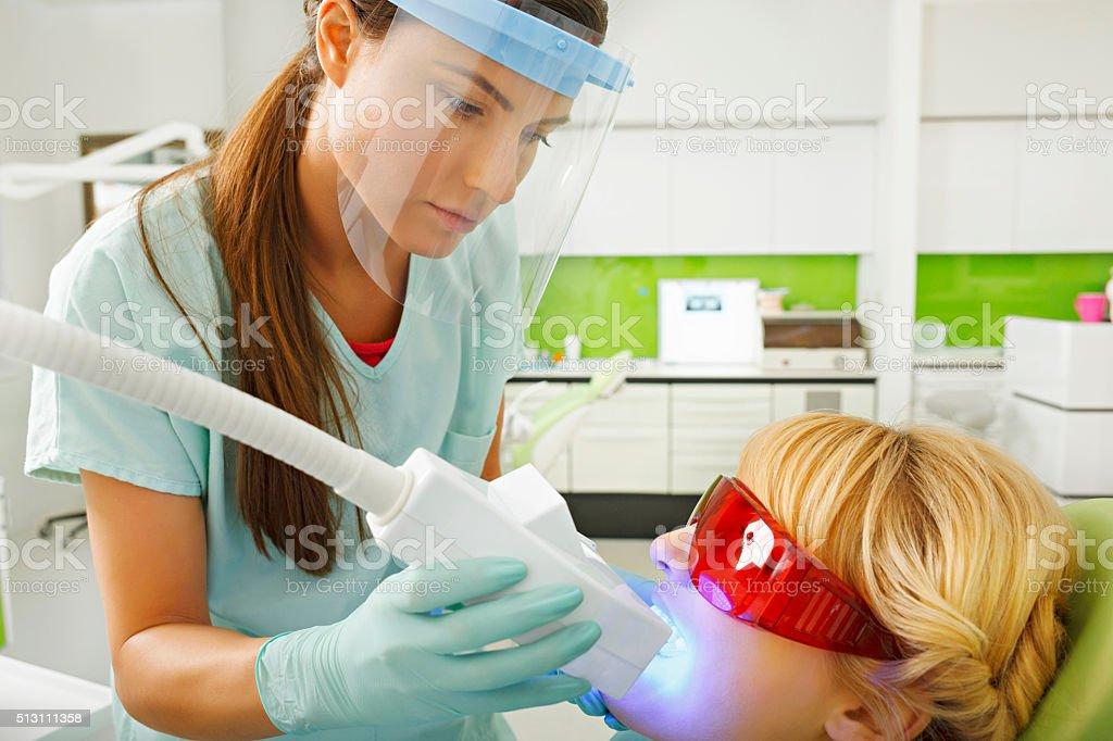 Dentistry  Dentist working    Teeth Whitening Dental Medical Process stock photo