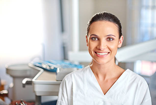 dentistry is her passion - dental assistant stock photos and pictures