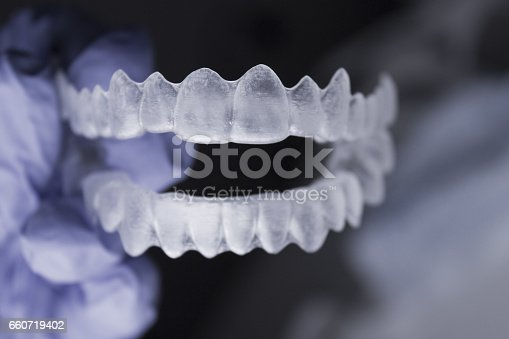 istock Dentists hand with latex gloves holding a dental orthodontic 660719402