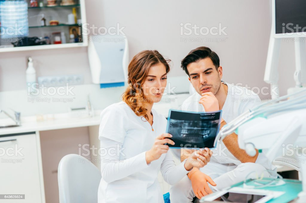 Dentists looking at an x-ray stock photo