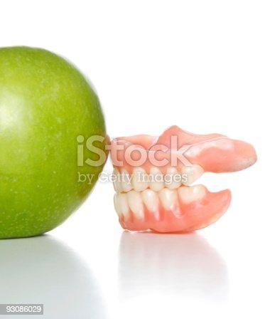 104545719istockphoto denture and apple 93086029