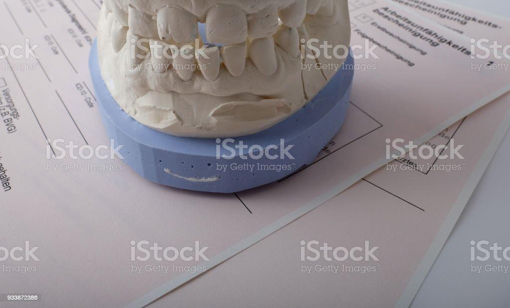 Denture on printed form 'Incapacity certificate' stock photo