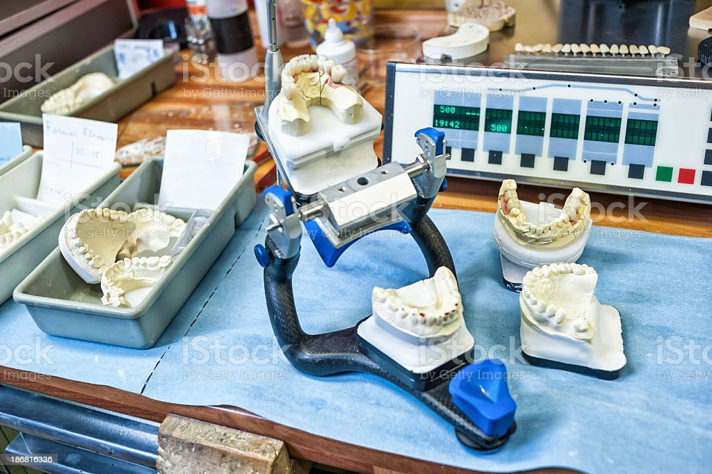 Dentures And Work Tools On A Desk stock photo