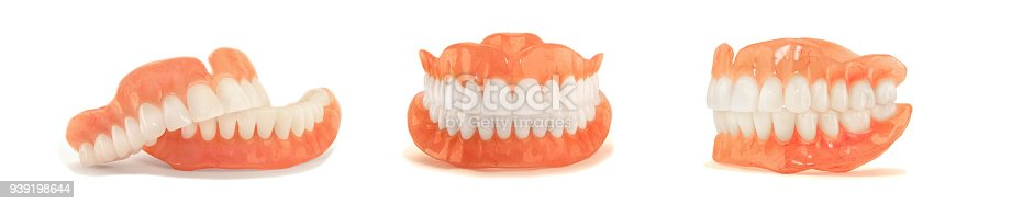 istock dentures. Isolate on white background acrylic prosthesis of human jaws. The concept of orthopedic dentistry 939198644