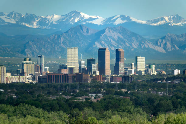 Denver Colorado downtown skyscrapers Boulder Flatirons red rocks Indian Peaks Rocky Mountains stock photo