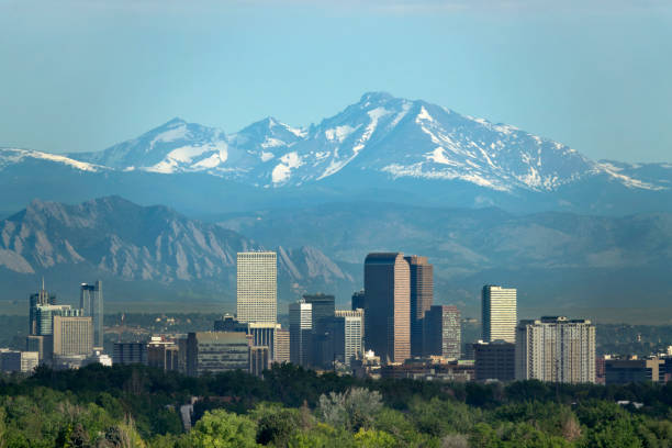 Denver Colorado downtown skyscrapers Boulder Flatirons red rocks Longs Peak Rocky Mountains stock photo