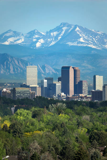 Denver Colorado downtown skyscrapers Boulder Flatirons red rocks Longs Peak Rocky Mountains The snow covered Rocky Mountains and Longs Peak rises over the Boulder Flatirons and Downtown Denver skyscrapers, hotels, office and apartment buildings. rocky mountains north america stock pictures, royalty-free photos & images