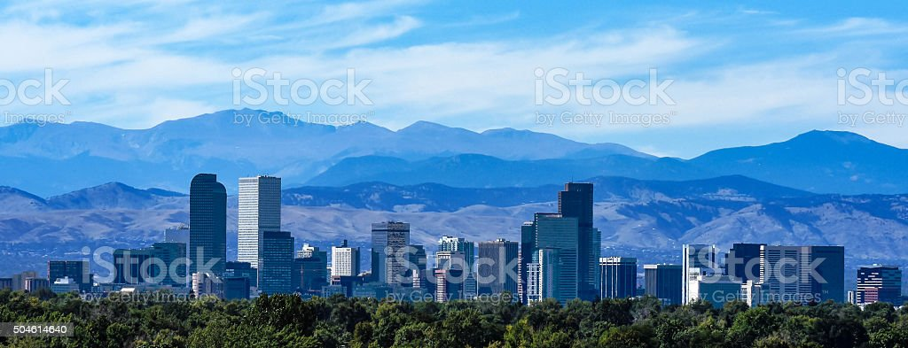 Denver Colorado Skyline Against the Rockies stock photo