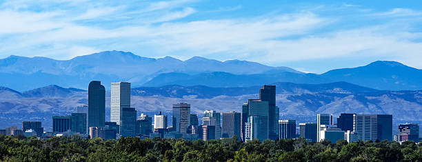 denver colorado skyline against the rockies - mountain range stock photos and pictures