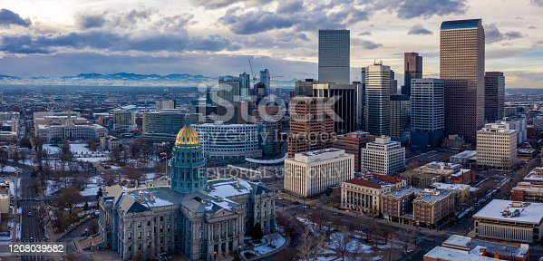 Colorado State Capitol Building & the City of Denver Colorado at Sunset.  Rocky Mountains on the Horizon