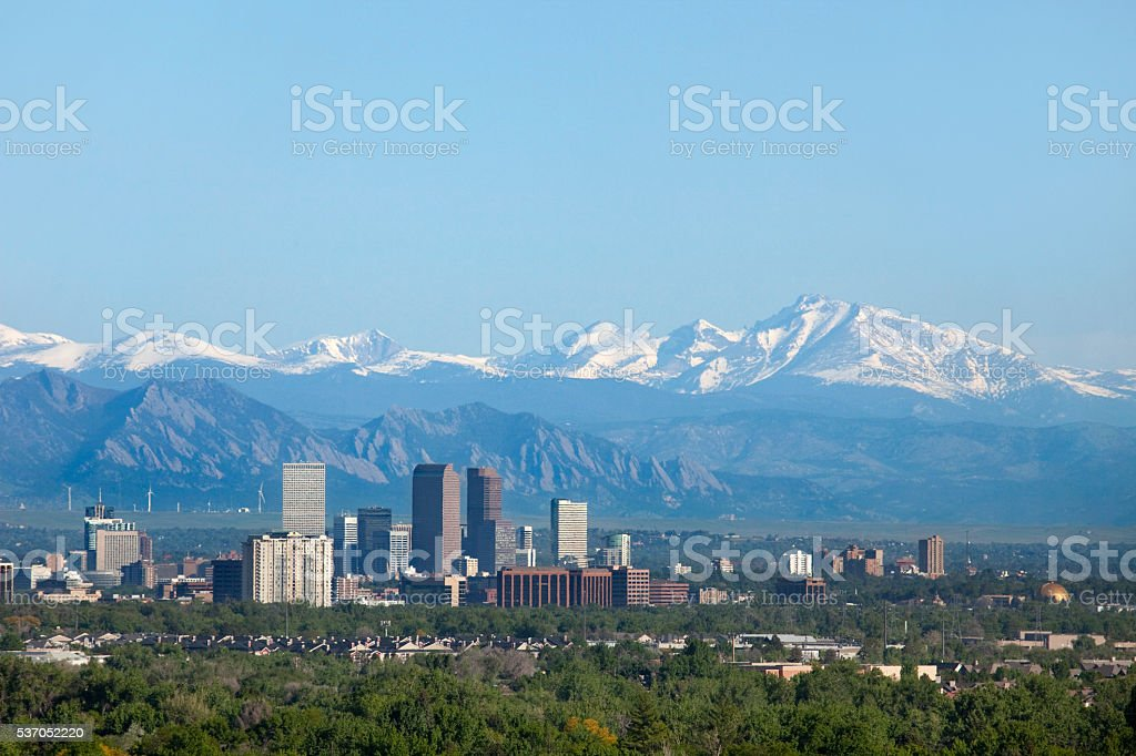 Denver Colorado skyscrapers snowy Longs Peak Rocky Mountains copy space