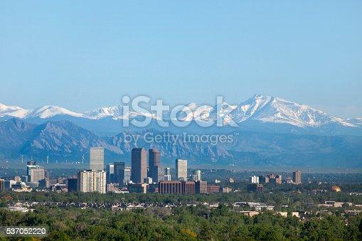 istock Denver Colorado skyscrapers snowy Longs Peak Rocky Mountains copy space 537052220