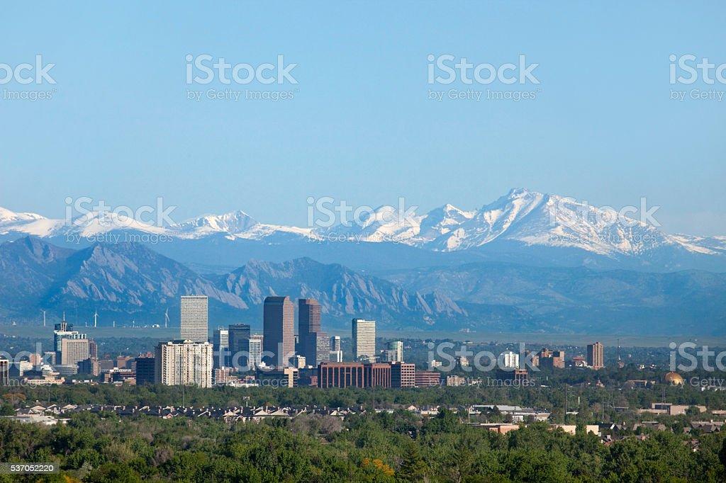 Denver Colorado skyscrapers snowy Longs Peak Rocky Mountains copy space stock photo