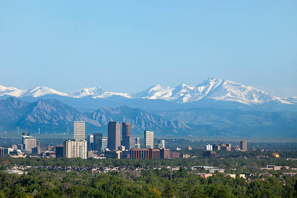 Denver Colorado skyscrapers snowy Longs Peak Rocky Mountains copy space stock photo