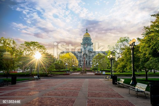 istock Denver Colorado state capital building with morning clouds in the sky 921353446