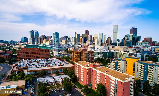 futuristic Denver Colorado USA skyline cityscape aerial drone view above Mile High City above green city park and huge lake