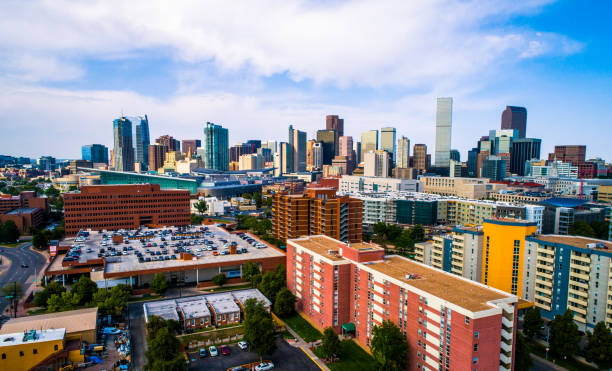 Denver Colorado urban cityscape skyline futuristic Denver Colorado USA skyline cityscape aerial drone view above Mile High City above green city park and huge lake denver stock pictures, royalty-free photos & images