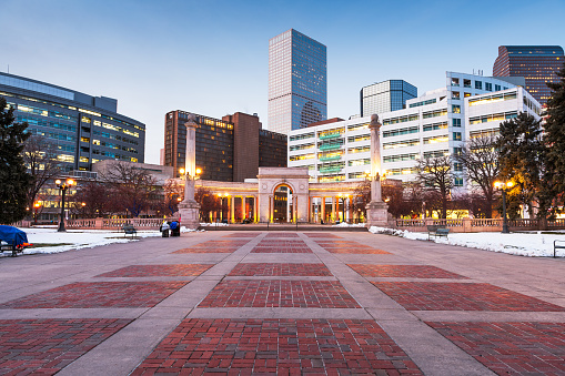 Denver, Colorado, USA downtown cityscape in Civic Center park at dusk.