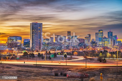 Denver, Colorado, USA downtown city skyline at dawn.