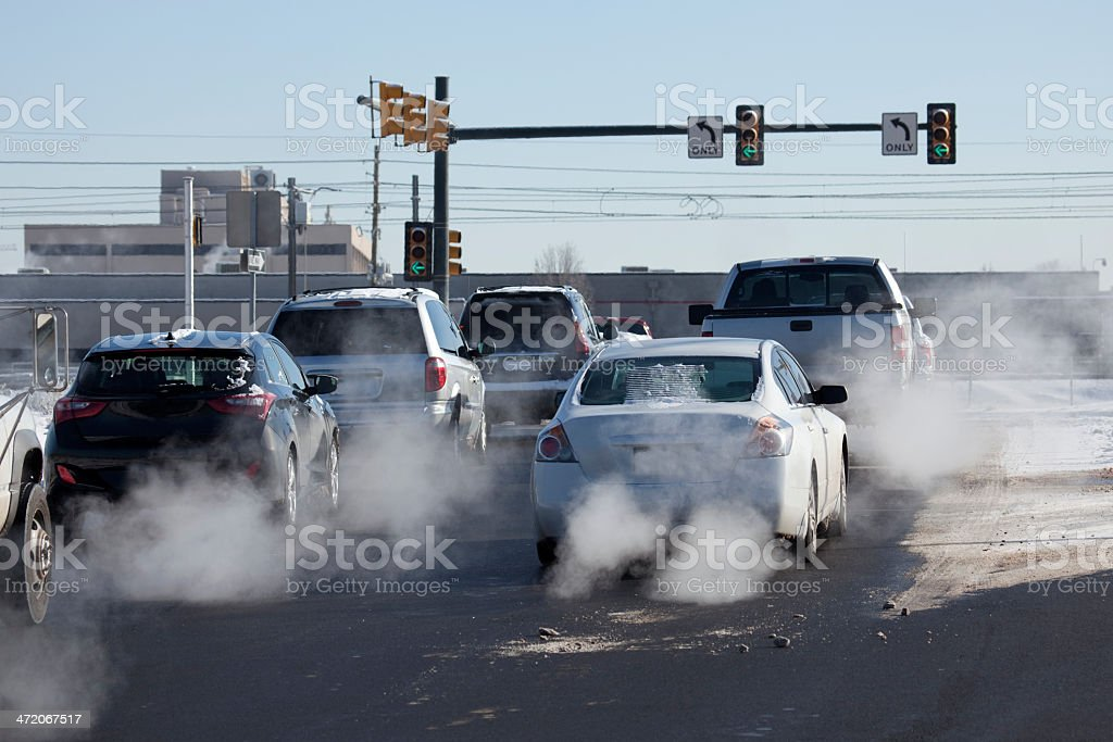 Denver Colorado vehicle tail pipe auto exhaust at busy intersection stock photo