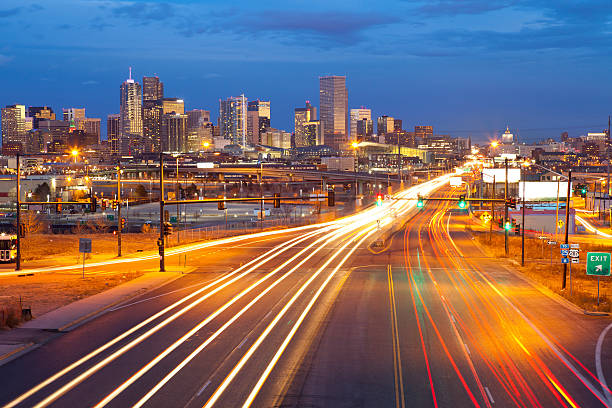 Denver. Image of Denver and busy street with traffic leading to the city. denver stock pictures, royalty-free photos & images