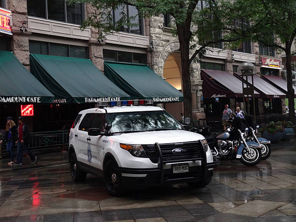 Denver Police SUV and Motorcycles park on promenade stock photo