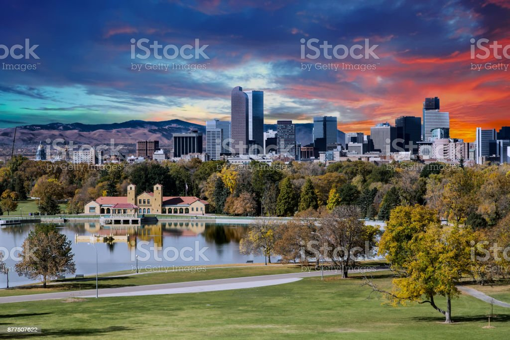 Denver Skyline and Mountains Beyond Lake stock photo