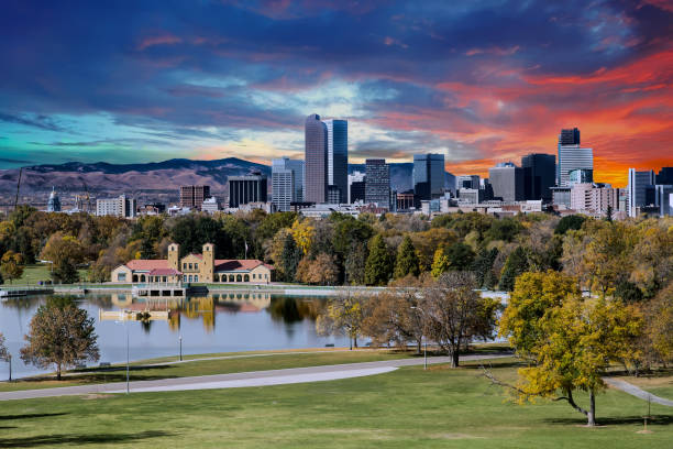 Denver Skyline and Mountains Beyond Lake Denver skyline across city park in autumn denver stock pictures, royalty-free photos & images