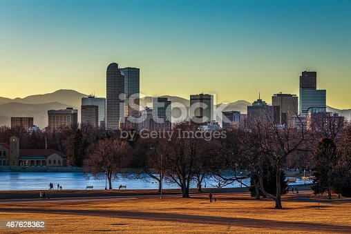 Denver City skyline and City Park at sunset in warm orange glow