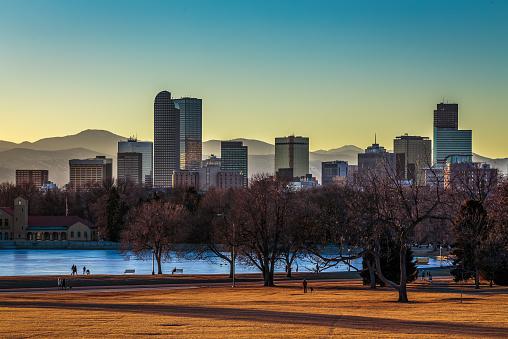 Denver City skyline and City Park at sunset in warm orange glow